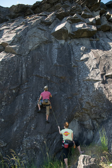 """Working through the first move on 'Apron"""" (5.10a). The crack following the ceiling is the best feature of this climb."""