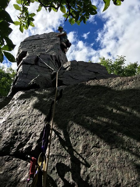 "Jacob K. leading the summit block of Cleo's Needles ""East Comfort"" Route"