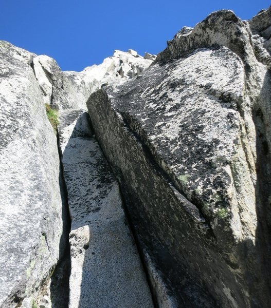 I suspect this is the 10+ crack (60-70' into P2) that Erroneous & co climbed.  We went right at this point instead of climbing the crack.