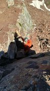 Climbing the crux on North Maroon Peak