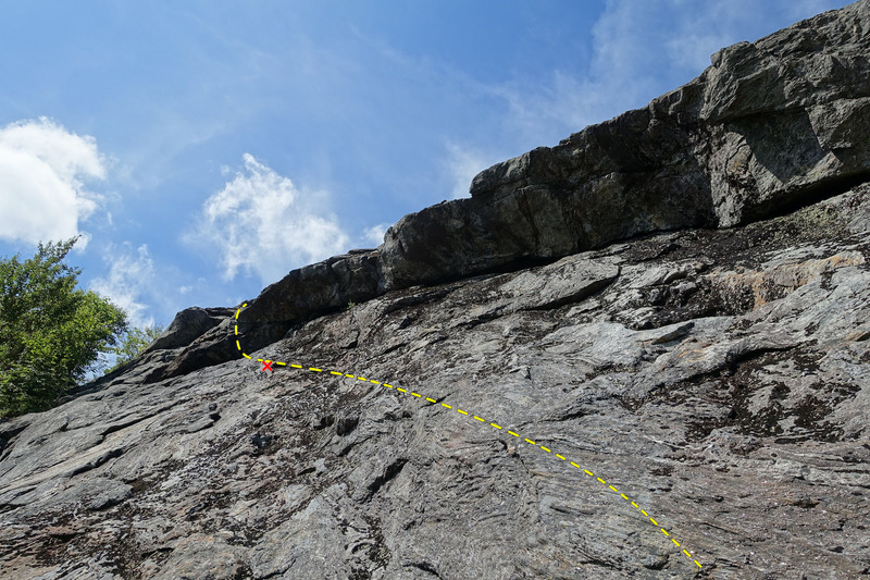 October Sundae Direct - Traverse left under the overhang, passing a bolt and surmount the overhang on the left end.