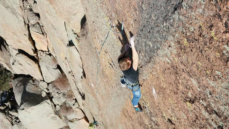 Cody pulling into the final headwall crux on the 3rd pitch.<br> <br> Photo by Eric Schmeer.