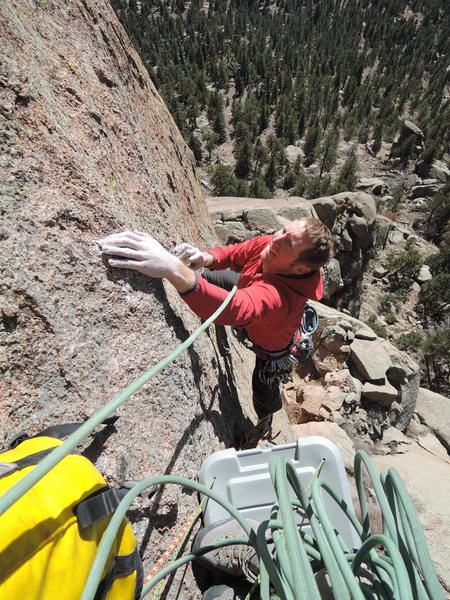 Cody following the 5.12 pitch. Note the makeshift, action packer belay ledge.  Gotta stay comfortable on a budget!