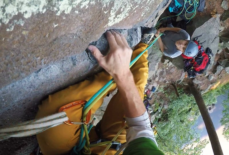 Coming to terms with the opening moves of Layback Crack (5.8) while on redpoint lead at Interstate State Park on August 21, 2016.