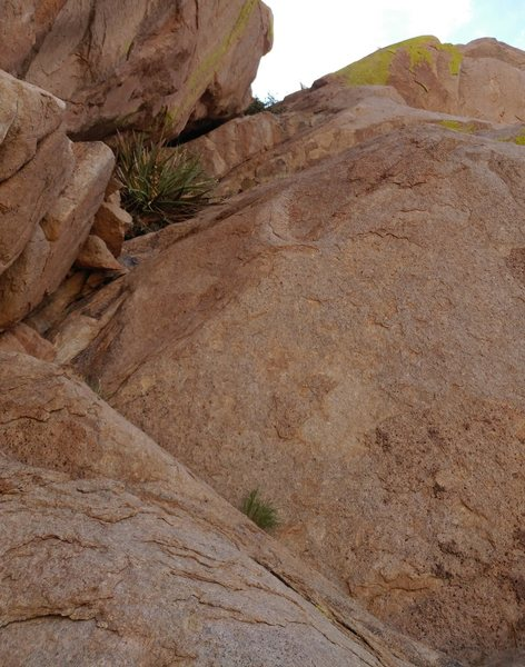This is a detailed view of the crux pitch. The thin right leaning crack is visible in the upper part of the photo