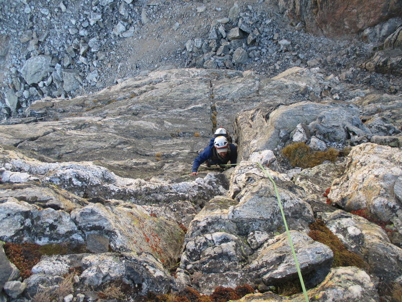 Nick Direen climbing Pitch 2, the 5.7 crux.