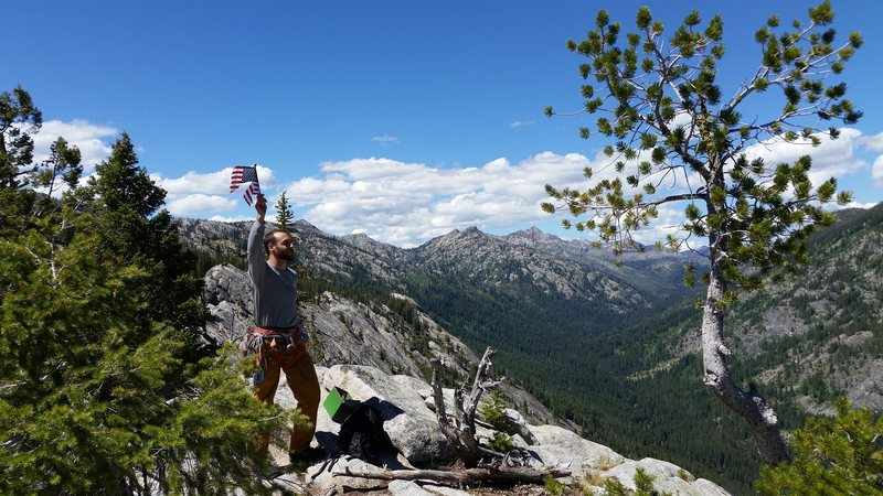 Mike overcome by patriotism on top of Slick Rock (McCall)