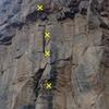 Julius Squeezer starts up huecoed arete behind climber.
