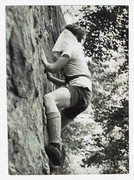 "Climbing on the center portion of Nubbin Face blind-folded and against the clock circa 1968-69?. Shoes are ""RR"" (Royal Robbins, shorts by scissors and Levi Strauss. I am the person in the photo, but i do not recall if the photographer was Richard E. Milller, Dennis Grabnegger, or Joe Ebner.  (it's been a while, and i was blind-folded) just something to pass the time when traffic jams occurred on more serious routes and/or when the route that was  of interest to you was unavailable for whatever reason. it was fun. Guessing, it was 5.2 or 5.3 in difficulty,  and still probably is, even blind-folded; but you did have to change your approach to route finding!"