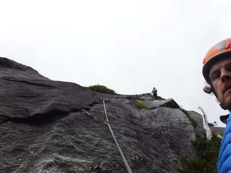 Passing the old anchors, stoked for the 5.10+ finger crack ahead on pitch 6.