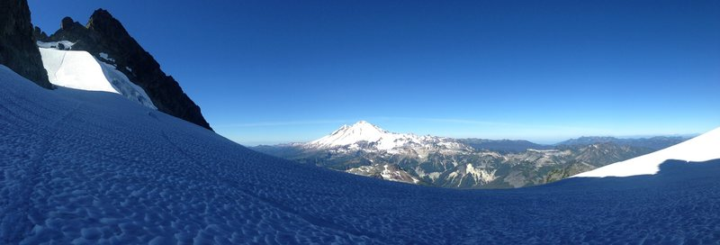 Pano showing typical snow-climbing conditions in August. There were two steeper sections (~60 deg) about 30-50 long of snow with some ice. The upper step is illuminated in the sun here.