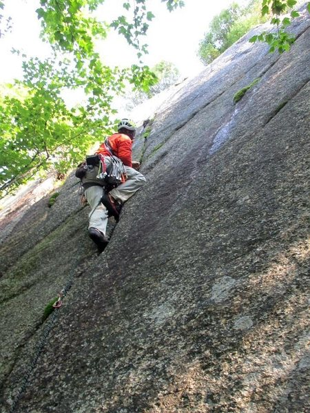 "Starting up the right-most route on the Slab, ""The Tao of Alces"" (5.6 PG) on the first ascent."