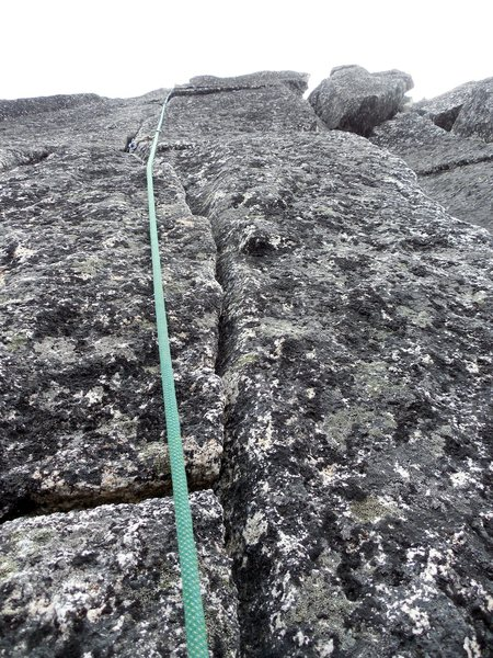 somewhere on route. lichen crack climbing.
