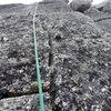 somewhere on route. lichen crack climbing.