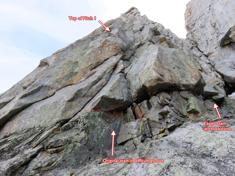 Start of SW Arete. Looking up Pitch 1, which starts at a black dike. There are two ways to start this pitch, shown in the photo. Either climb directly up via a difficult groove (as the first ascent party did) or surmount the easier overhang/chockstone to the right. Then climb up and left towards the crest.