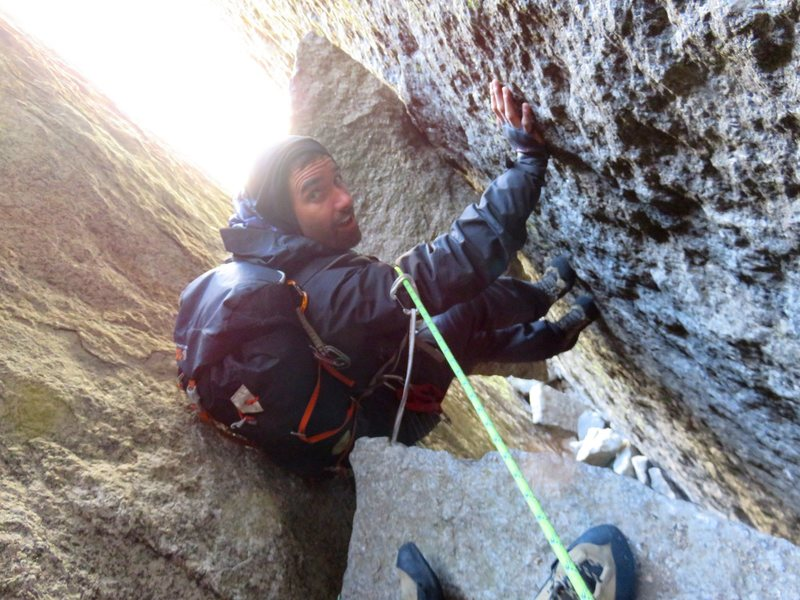 Rock Climbing Photo: Pitch 3. Jeff chimneying to the chockstone belay. ...
