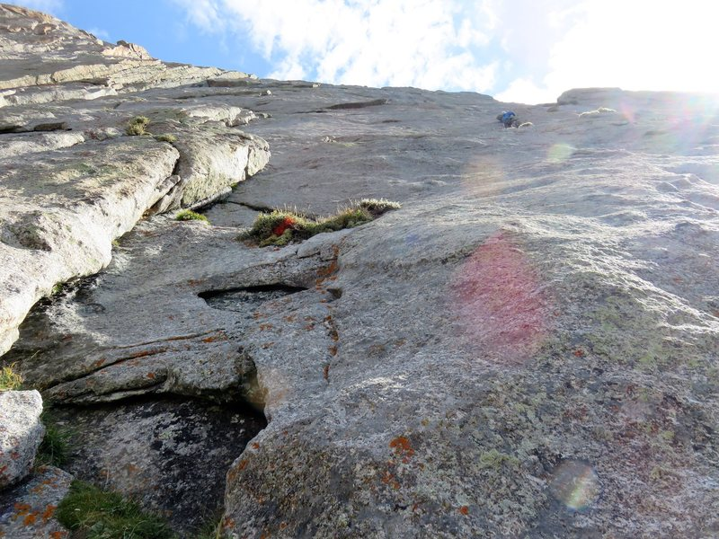 Rock Climbing Photo: The third pitch starts with a tricky slabby traver...