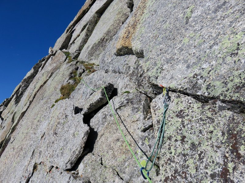 The route ends by traversing this diagonal weakness across the face to the summit ridge.