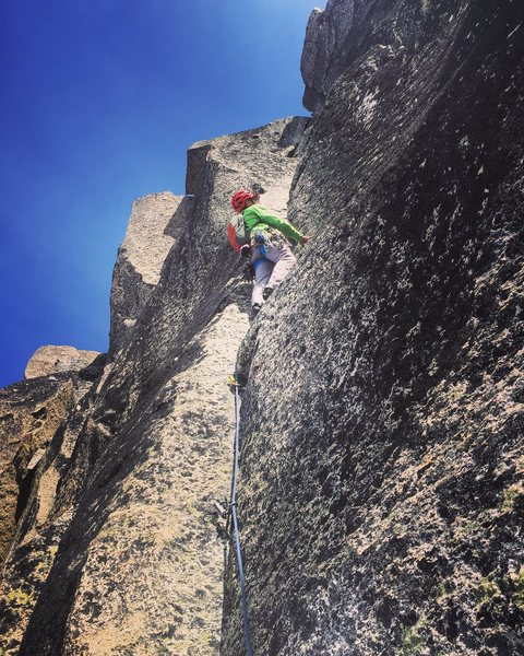 """Above the """"scary slab"""" is this impeccable 5.8 hand crack that leads to an exhilarating 5.9+ squeeze. Best pitch on the route!"""