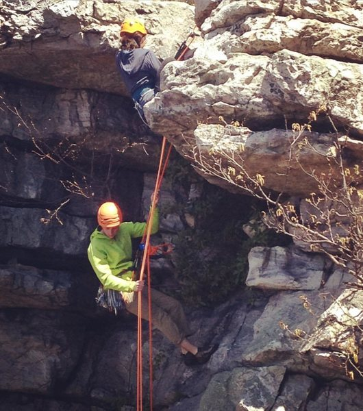 Instructing a rappel for a client at Annapolis Rocks