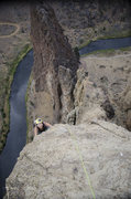 Rock Climbing Photo: Follower pulling up onto the final slab on the las...