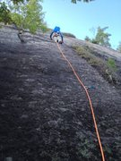 Rock Climbing Photo: Clipping the 3rd bolt. The line goes up and right ...