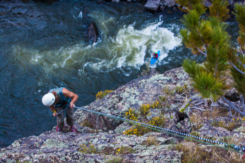 Rock Climbing Photo: Griff rapping down as a kayaker floats by undernea...