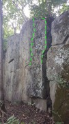 Right side of the Boulder. Climb the arete or move just a little to the left and climb the face