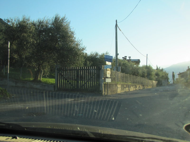 "Turn left here to follow the ""Scuderia Castello"" sign."