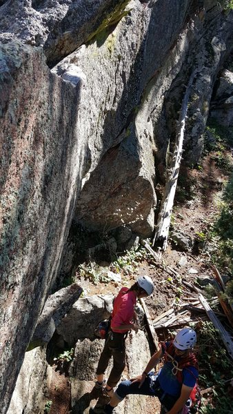 A view from the tree of the downclimb. Notice the chalk on the ridge for the handhold.
