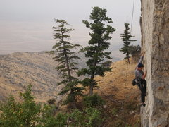 "Rock Climbing Photo: Sam top-roping ""Huck You"" before the fog..."