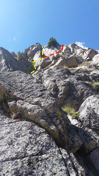 Looking up at pitch 2. The yellow line is the dihedral we backed off of, and the red line is the route we topped out with.