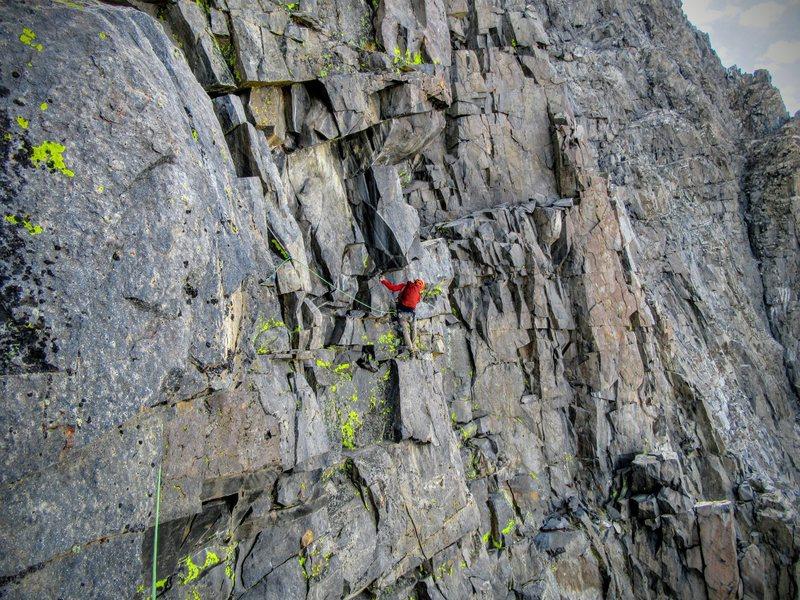 Neil Kauffman on the crux traverse, East Corner of  Banner Peak III 5.7