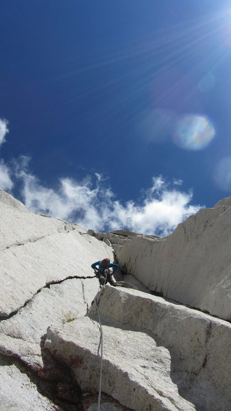 Rock Climbing Photo: Aaron following P6 under bluebird skies on the FA