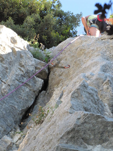 Rock Climbing Photo: Clip the last bolt on the right wall of the dihedr...