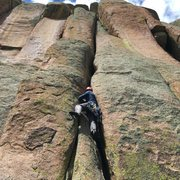 Mike beginning up the sustained offwidth Snake, 5.9.
