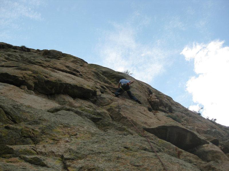 Lynn sending the steep fun 5.10 climbing on the beginning of pitch 2.
