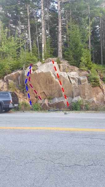 Toyota Tacoma in the left side of the picture for height reference. As you can see, it&@POUND@39@SEMICOLON@s a pretty tall boulder, maybe 25 ft. at its apex! (you can just make out the crash-pads in the center of the boulder as well)<br> <br> Blue: Monkey-Pants (Left),V5-<br> Pink: Monkey-Pants (Direct),V7+<br> Red: Playing Hookie, V3