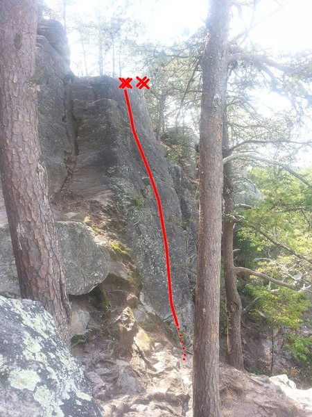 Side view of the licheny slab.  Approach descent to the lower section is immediately below the slab