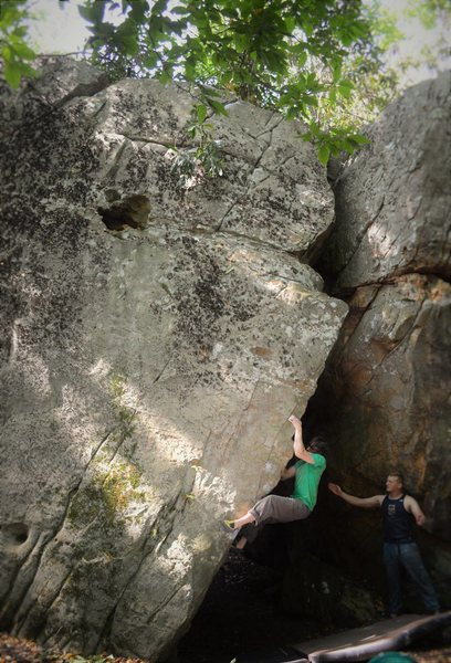 "Christian Backman crushing the arete pinch of ""Allegory of the Cave""(V4)"
