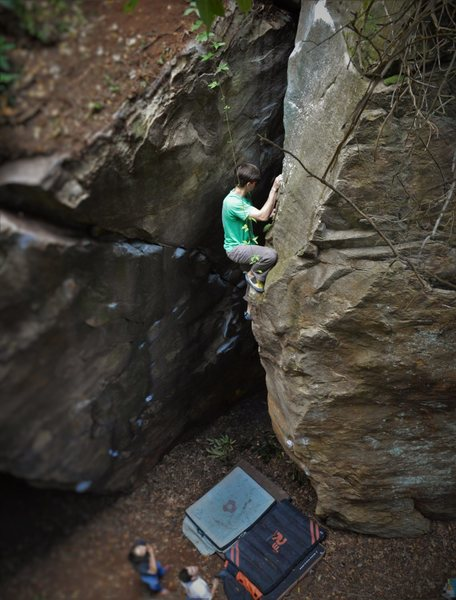 "Christian Backman getting some air under his feet on the classic Labyrinth highball ""Hell or High Water"" (V5)"