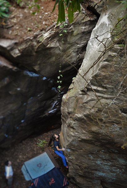 "Sierra Tackling the low crux before entering higher ground on ""Hell or High Water""(V5)"