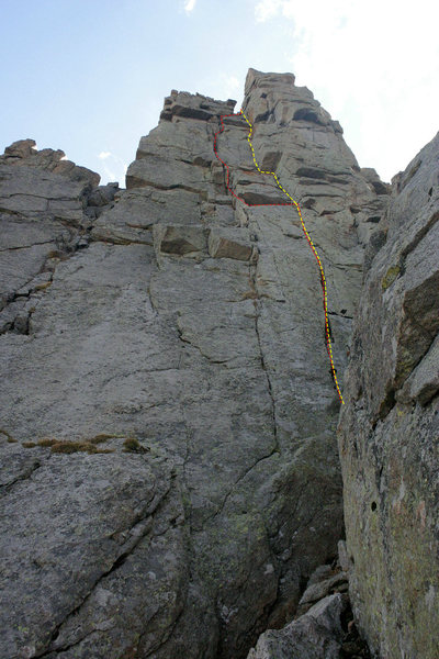 Straightened out route: on the FA, several loose blocks caused a diversion to the left crack system. After those blocks were cleaned on rappel, the line now goes straight up a single dihedral system.