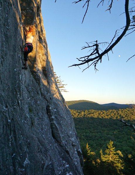 Jamie Trayer follows the last rays of the sun across the Monkey traverse.  Photo: Ian Kirk