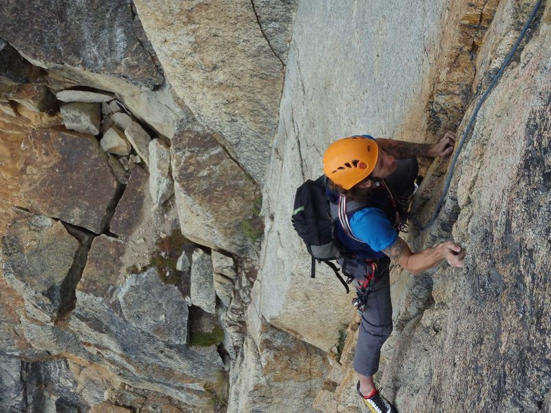 Following our 3rd pitch, before the 10- traverse rightward. The broken ledge system with loose blocks is visible below.