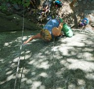 Working on the finish of Silver Spot. The key to the finish is high stepping the chocked foothold to the right of the climber's knee looking down.