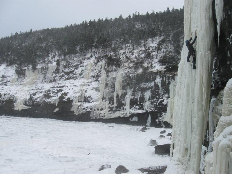 Climbing &quot@SEMICOLON@The Reaper&quot@SEMICOLON@ in Deadmans Bay on a day with a rough sea.