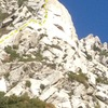 Very rough line of ascent. Climber on the Fin Arête. See the Granite Guide for a better beta photo