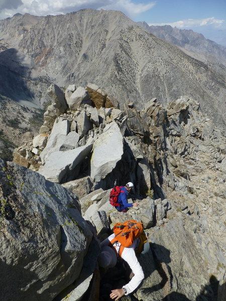 Descending the knife-edge summit ridge on Independence Peak
