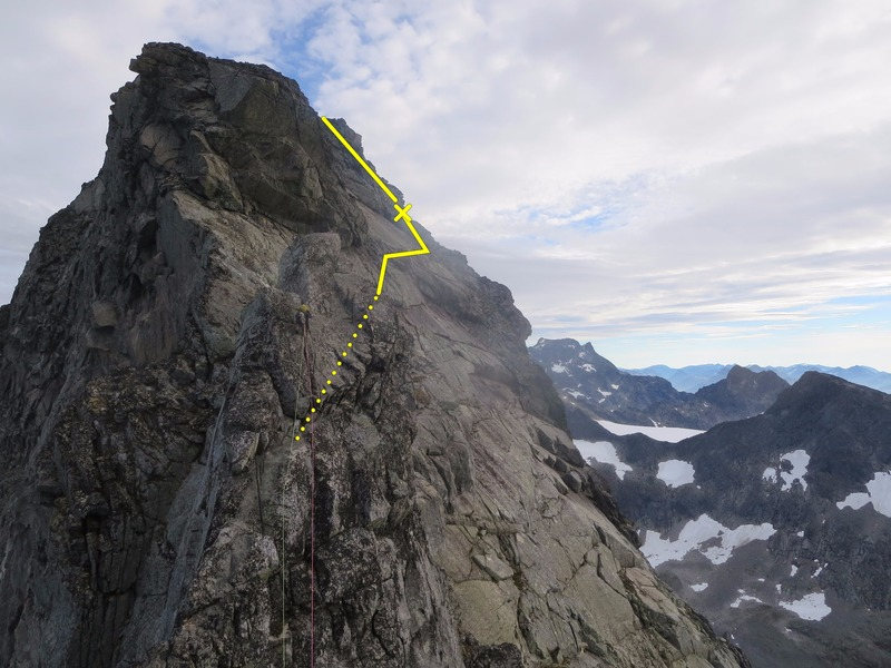 Climbing up to the pinnacle before Søre. Follow the line for best/easiest ascent on other side.